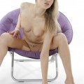 Eva in purple chair