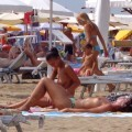 Girls sunbathing on italian beach of the adriatic coast