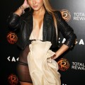 Adrienne bailon flashing the see-through dress