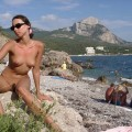 Cute brunette nude at public beach