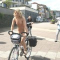Nudist woman with bikes