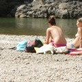 Topless nudist babes with tanga tanning in sun