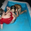 Party girls in club - fighting in pool - wet t-shirt