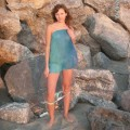 Brunette teen teasing on nude beach - 4