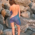 Brunette teen teasing on nude beach - 5