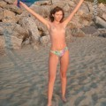 Brunette teen teasing on nude beach - 7