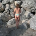 Brunette teen teasing on nude beach