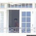 Rihanna naked ass and topless boobs candids through her balcony window - celebrity